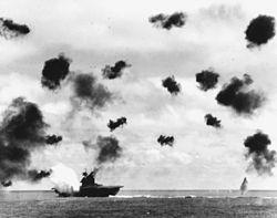 USS_Yorktown_(CV-5)_is_hit_by_a_torpedo_on_4_June_1942.jpg
